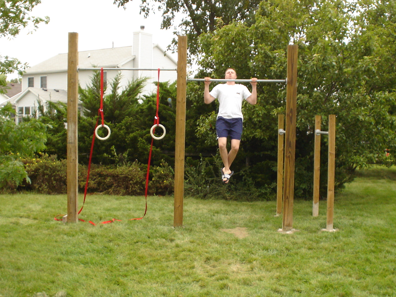 Backyard Gymnastics Bars : We started this in my backyard, my friend Brandt helped me build this